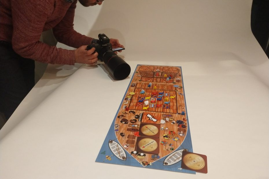 Owen takes a photo of the board game